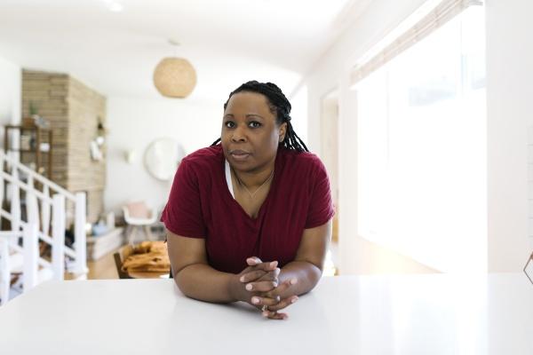 portrait, of, woman, leaning, against, kitchen - 30267574