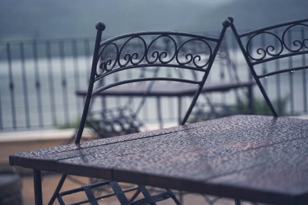 black iron metal chairs near table