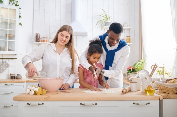 happy family cooking cakes on breakfast