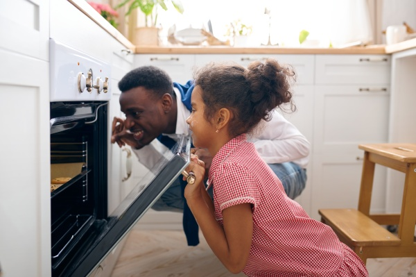 father and kid cooking cakes in