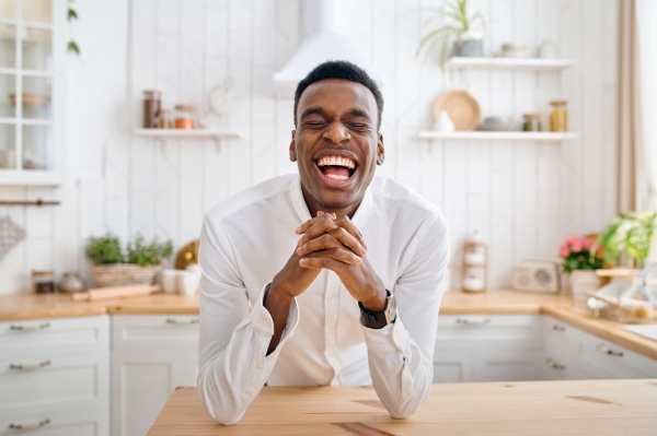 laughing man sitting at the counter