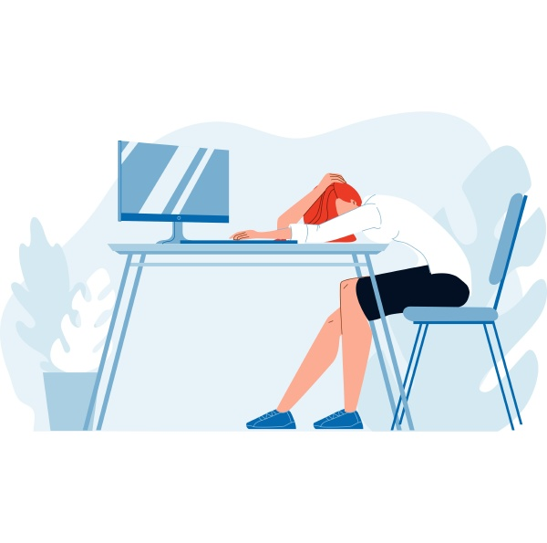 business woman asleep at desk in