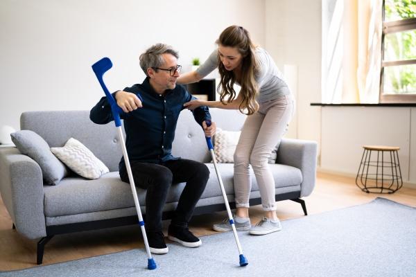 woman helping injured handicapped man