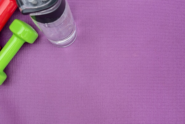 ladies dumbbells and water bottle over