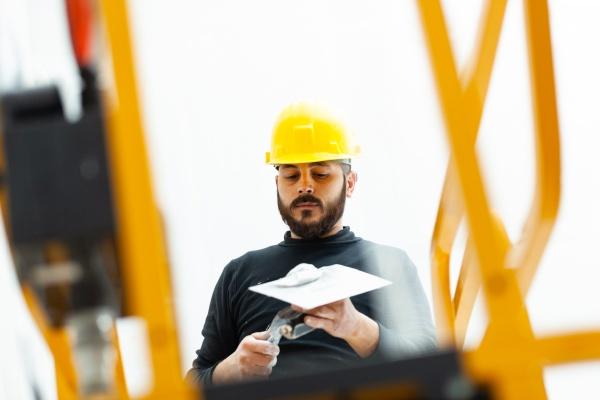 worker plastering gypsum board wall