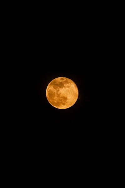 full super moon over dark black