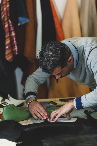shoe designer working with leather