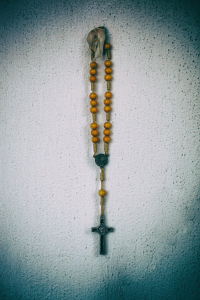 rosary hanging on the wall with