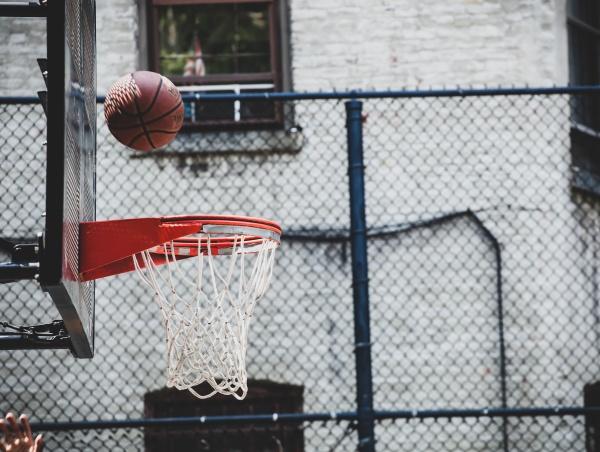 basketball hoop in a neighborhood playing