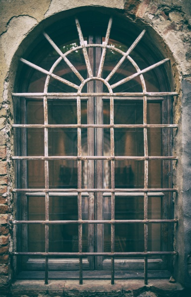 ancient medieval window with wrought iron