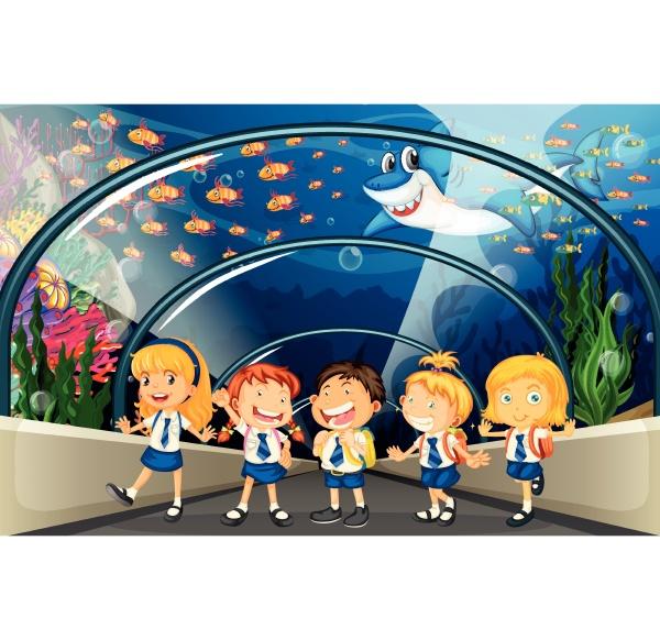students visiting aquarium with lots of