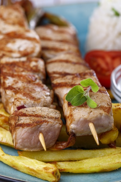 greek souvlaki skewers with french fries