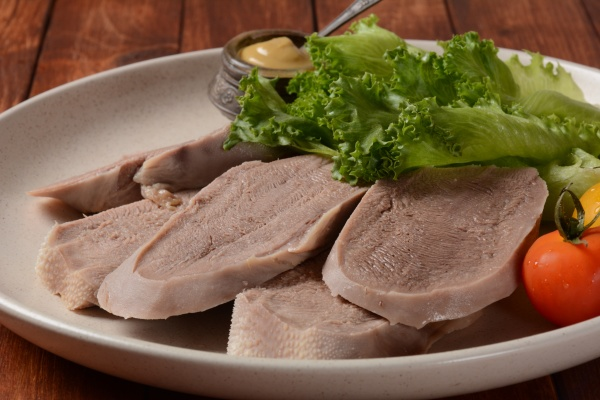 sliced beef tongue slices on a