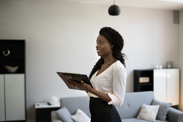 african woman real estate loan appraiser