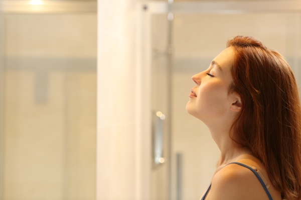 woman breathing relaxing in the bathroom