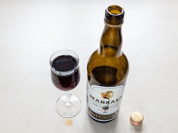 wineglass and empty bottle of sweet