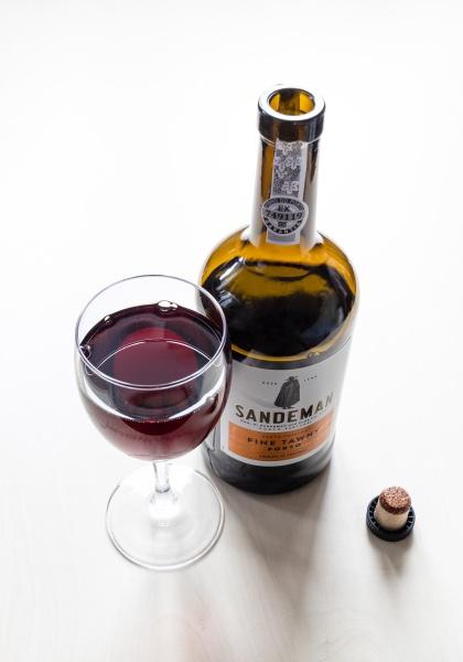 wineglass and bottle of sandeman fine