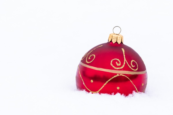 beautiful red christmas bauble on real