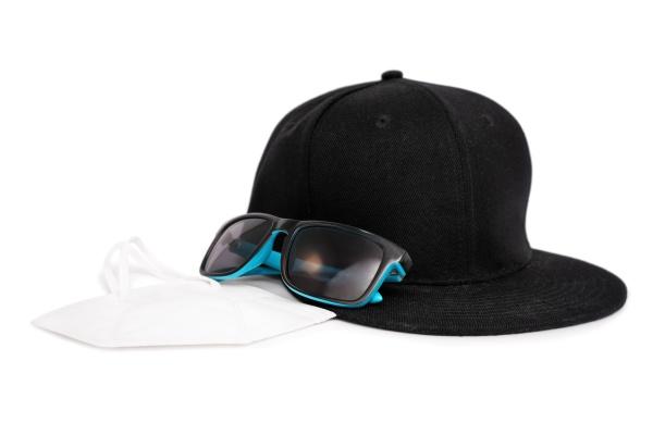 snapback cap sunglasses and a face