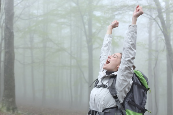excited trekker celebrating achievement in a
