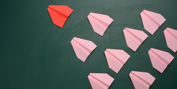 a group of pink paper airplanes