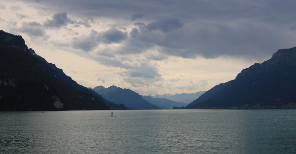dramatic sky over mountains and lake