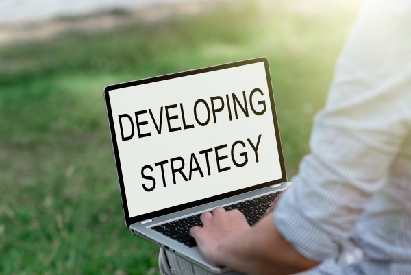handwriting text developing strategy business approach
