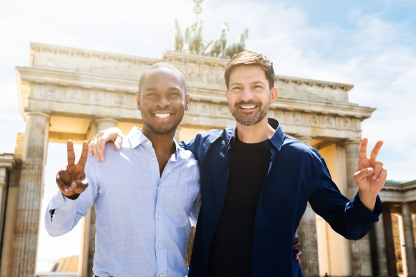 gay couple making victory signs