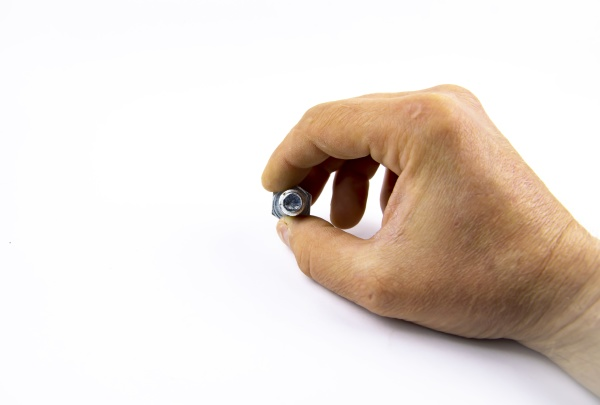metal bolt in a mans hand