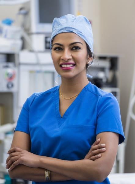 portrait of female doctor wearing scrubs