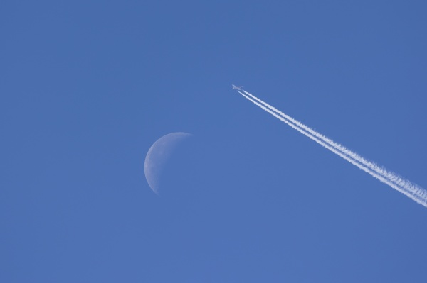 airplane leaving contrails against blue sky
