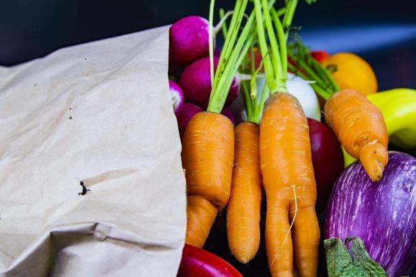 vegetables in a paper bag on