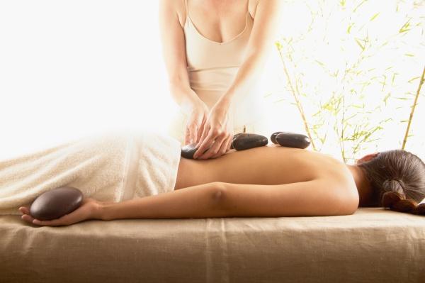 woman receiving stone massage