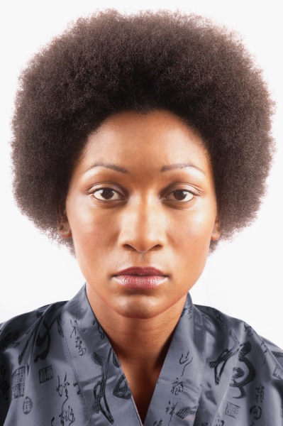 studio portrait of woman with afro