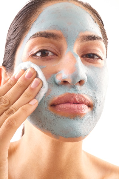 close up of woman removing blue