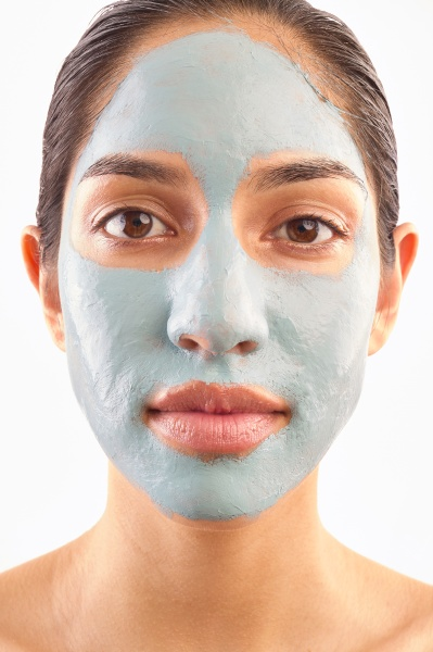 studio portrait of woman with blue