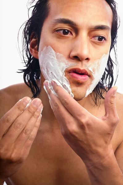 close up of man applying shaving