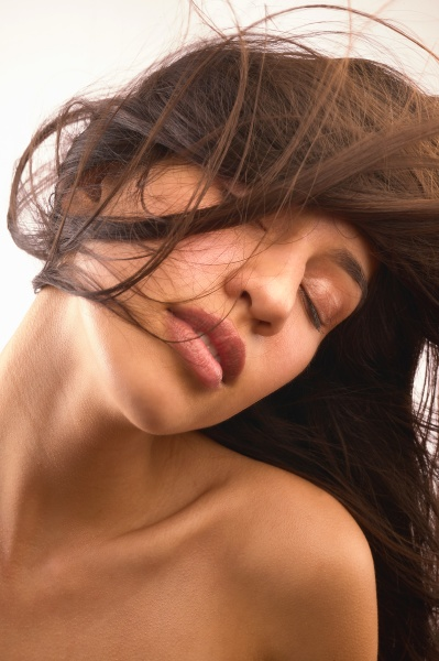 studio shot of shirtless woman with