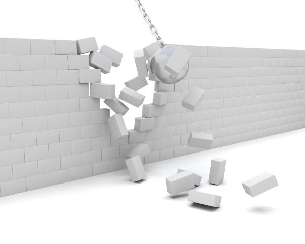 wrecking ball demolishing a wall