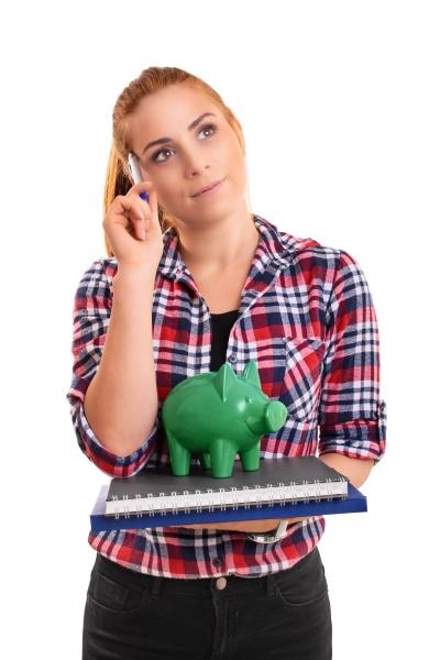 female student holding green piggy bank