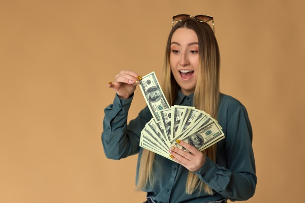 woman holds cash money in dollar