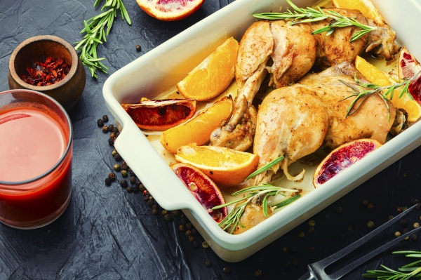baked chicken legs with oranges space