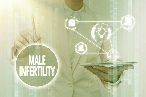 hand writing sign male infertility business