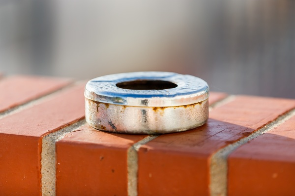 metal ashtray with morning dew lying