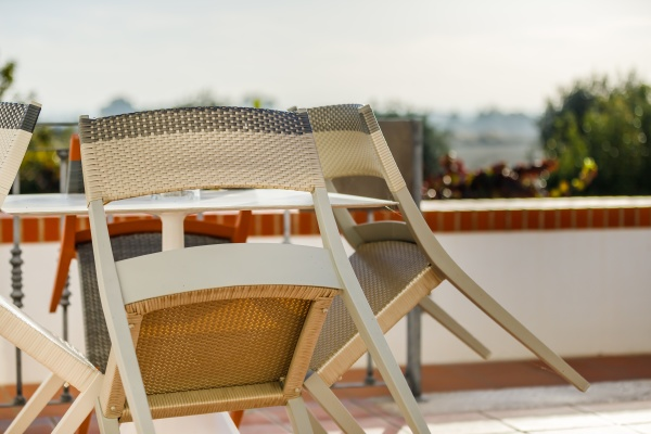 wooden garden chair leaning on a