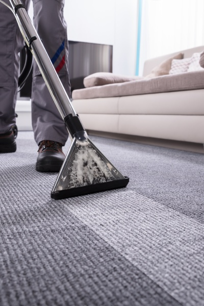 person, cleaning, carpet, with, vacuum, cleaner - 30668165