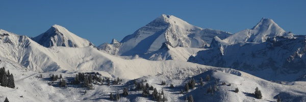 snow covered mountain peaks in the