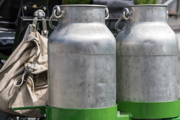 nostalgic milk cans and hiking backpack