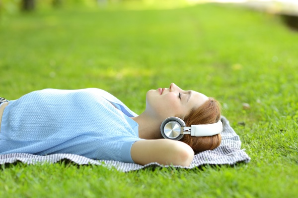 relaxed woman listening to music lying