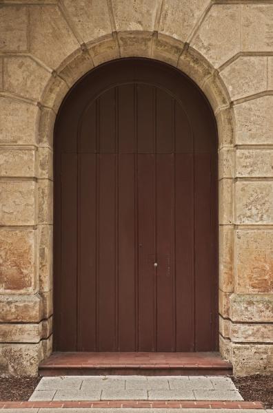 wooden door in stone arch